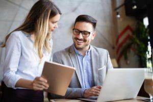 a pair discusses revwerx's verification of benefits services